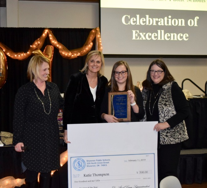 Katie Thompson, second from right, was announced as the Shawnee Public Schools 2019 Teacher of the Year. She is joined by (from left) Meggan Wilson, executive director of academics; Dr. April Grace, superintendent; and Ann Worden, Shawnee Early Childhood